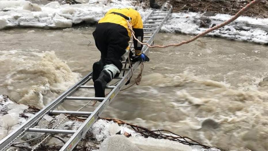 Fisherman stranded after falling through ice