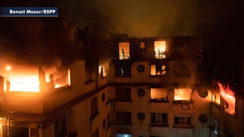 Suspect in custody following deadly apartment building fire in Paris