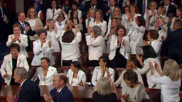 Women in white at State of the Union celebrate Trump's job creation statistic