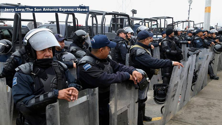 Mexico continues show of force at US border as thousands of migrants arrive