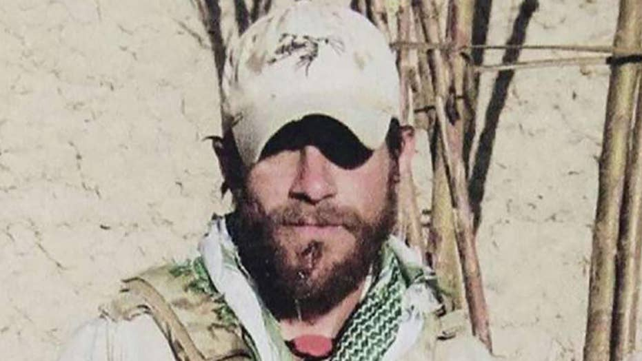 Judge drops 2 charges against decorated Navy SEAL facing war crimes prosecution