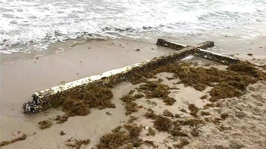 Giant cross washes up on FL beach
