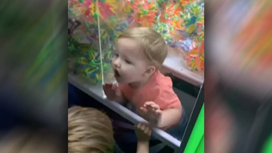 Raw video: Firefighters called to rescue kid trapped in claw machine