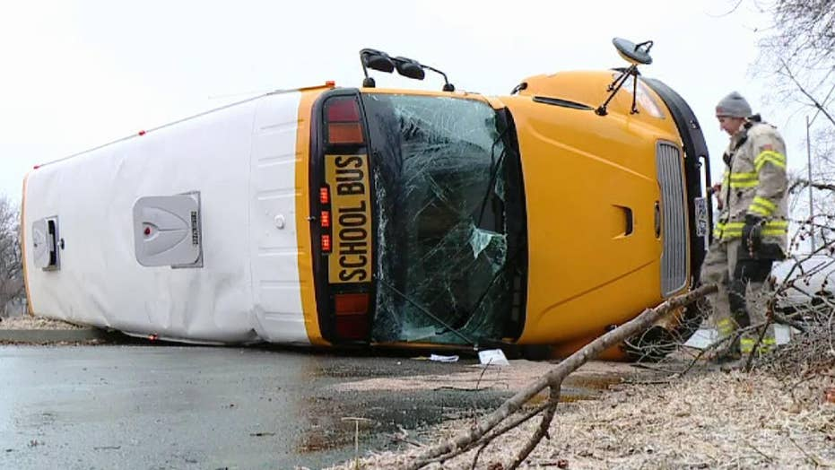 Dramatic video: School bus carrying 3 students overturns on