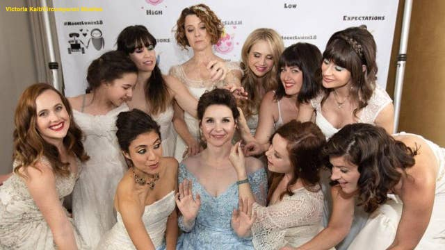 Bride invites her bridesmaids and guests to wear their own wedding gowns to her nuptials