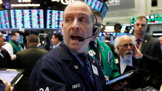 Dow closes higher for the seventh-straight week