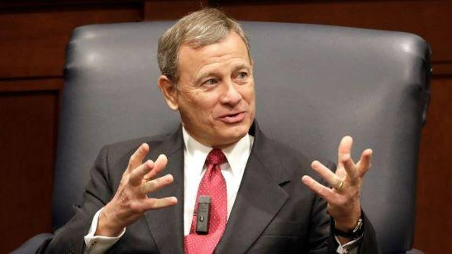 Chief Justice John Roberts joined the Supreme Court's liberal wing in temporarily blocking a Louisiana abortion law