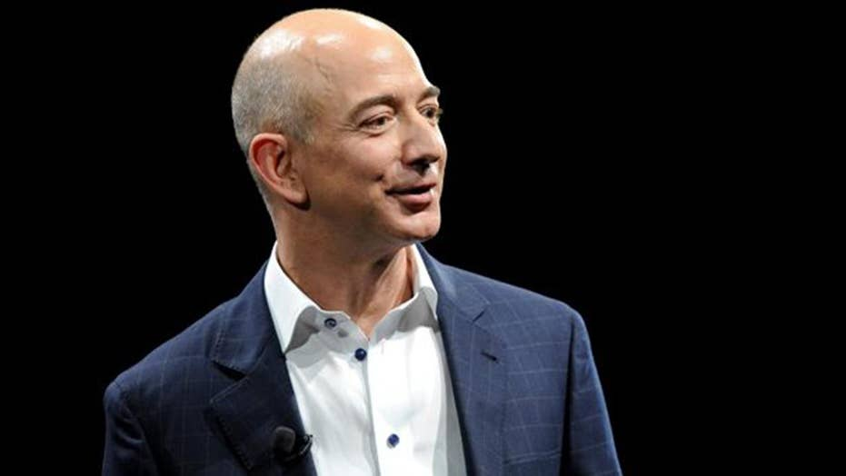 Jeff Bezos accuses National Enquirer's publisher of blackmail and extortion