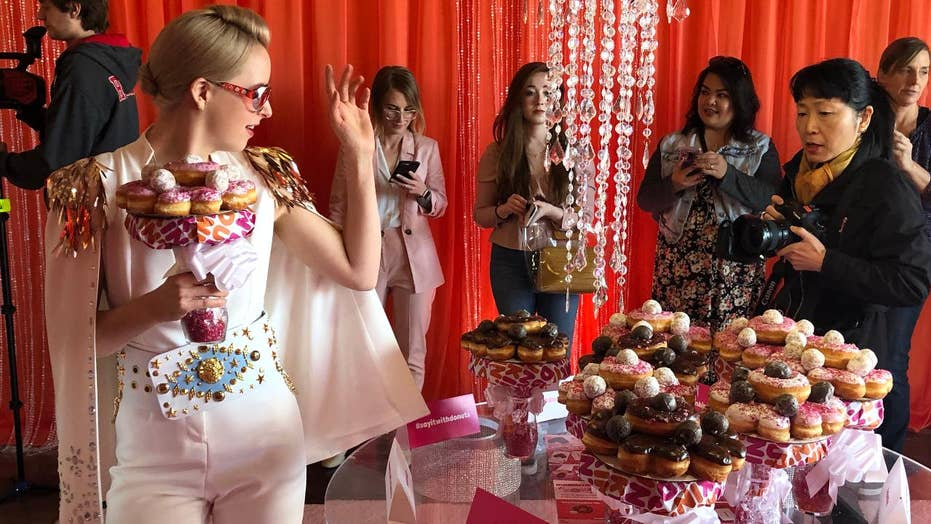 Couples get married with doughnut bouquets