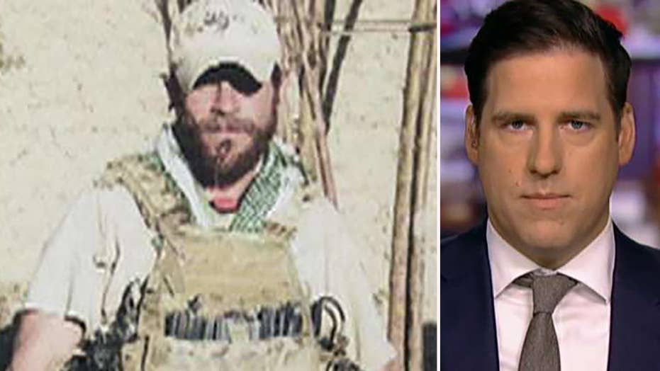 Decorated Navy SEAL's brother, wife say 'dirty games' by government