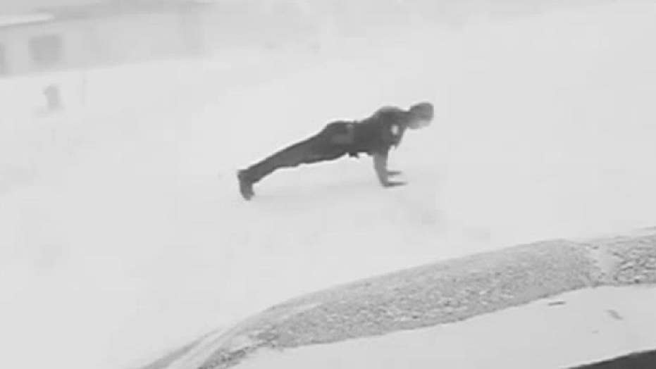 Fargo police officer does push-ups in the snow to honor fallen comrades