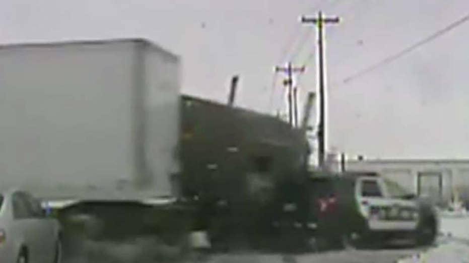 Semi-truck runs light, slams into police cruiser in Wisconsin