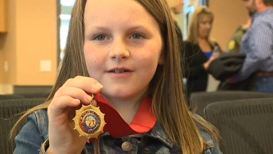 8-year-girl honored for saving her injured father's life during shooting spree in California