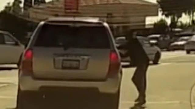 Dashcam video records a pedestrian intentionally trying to get hit by a vehicle