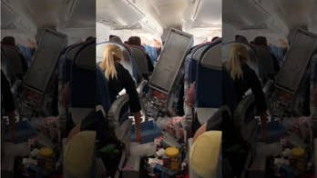 Delta flight 'did nose dive, twice,' makes emergency landing