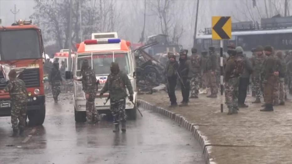 Deadly car bomb attack on an Indian military convey kills dozens in India-controlled Kashmir
