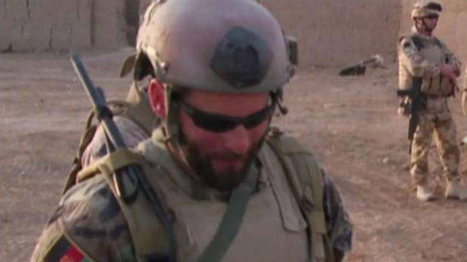 Green Beret facing murder charges wants case dropped because of investigator's 'stolen valor' charges