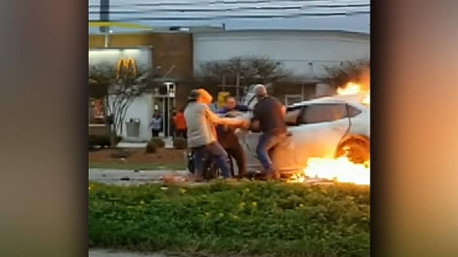 Brave bystanders pull woman through window of burning car in Louisiana