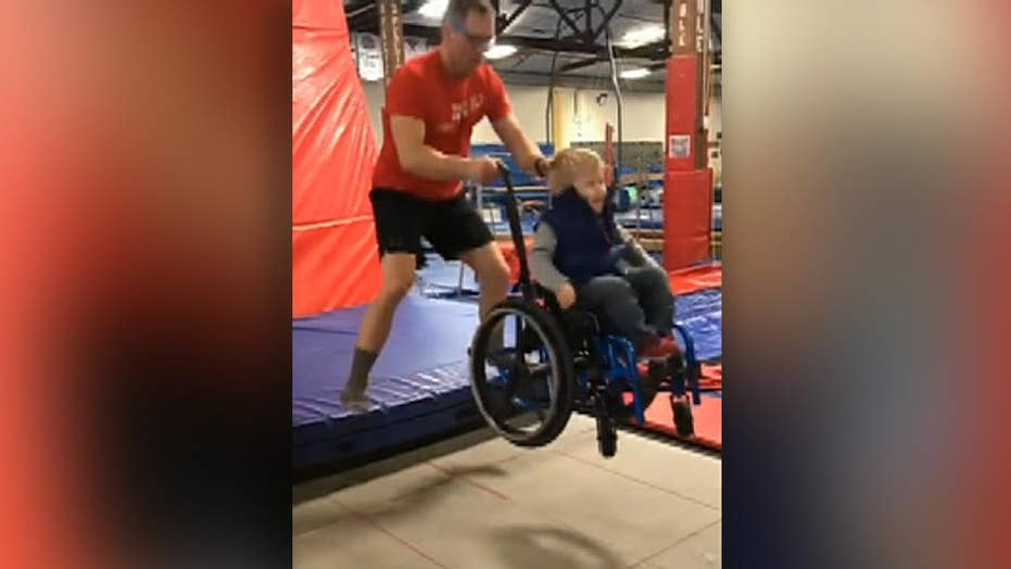 Video of boy in wheelchair taking his turn on a trampoline goes viral