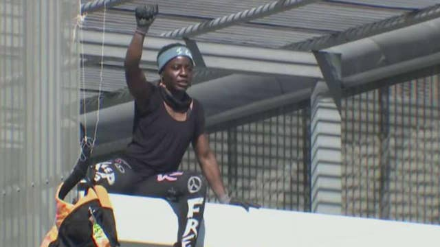 Statue of Liberty climber arrested again in Texas protest stunt