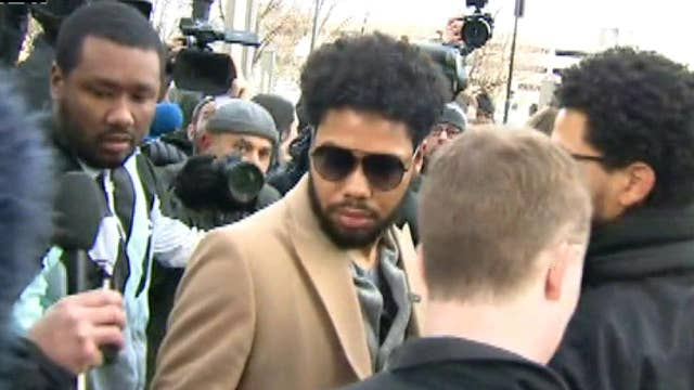 Reporters swarm Jussie Smollett as the 'Empire' star leaves his bond hearing in Chicago