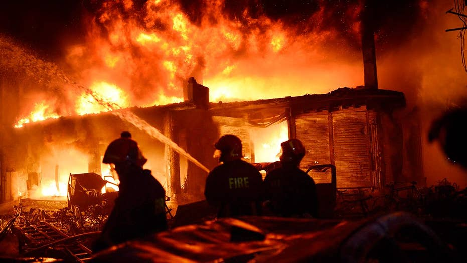Crews battle huge, deadly fire in Bangladesh
