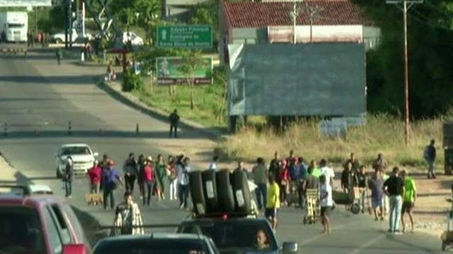 Venezuela facing new unrest after Maduro closes border with Brazil