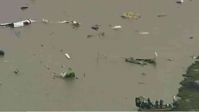 Cargo plane crashes in Trinity Bay, Texas.