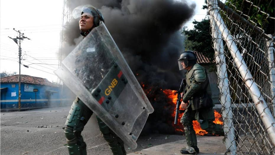 Venezuelan troops abandon posts amid violent clashes with protesters