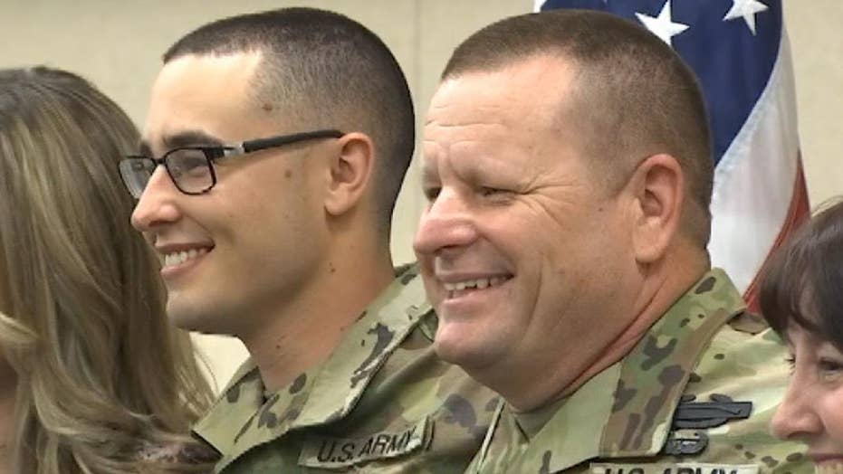 Army father and son deployed together overseas on mission in Afghanistan