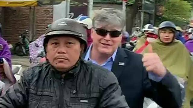Sean Hannity commutes to set via scooter in Vietnam