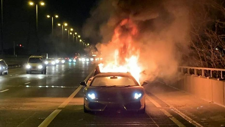 $150,000 Lamborghini bursts into flames moments after leaving garage