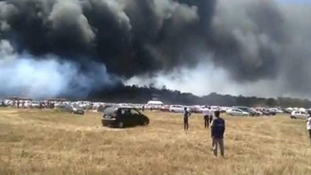 Parking lot fire burns over 200 cars