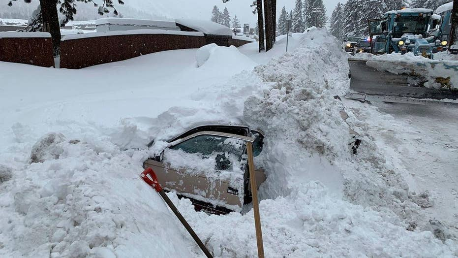 Snowplow hits buried car with woman stuck inside