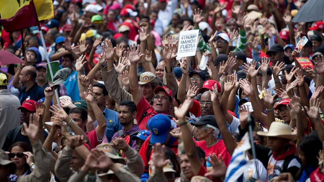 Venezuela power struggle takes on Cold War overtones as US, Russia stand on opposite sides