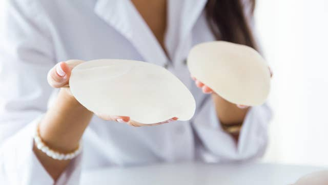 Woman's cancer linked to butt implants