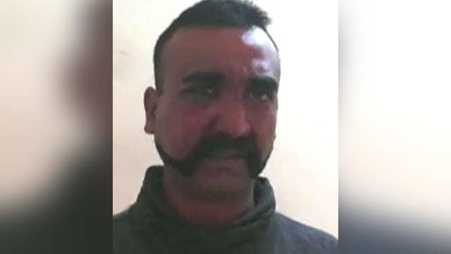 Indian pilot welcomed home as hero after being shot down, captured by Pakistan