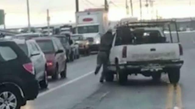 Video shows man attacking pickup truck in apparent road rage incident