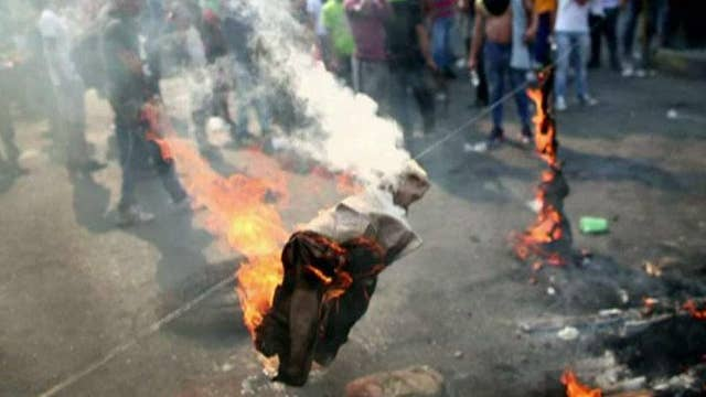 Chaos in Venezuela and tension between Pakistan and India spark fears of global unrest