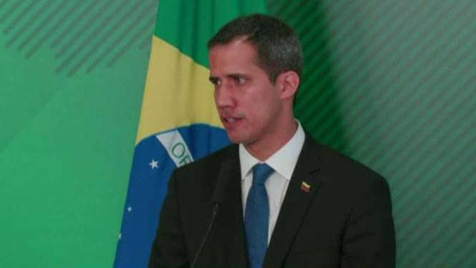 Venezuelan opposition leader Juan Guaido disobeys a travel ban put in place by President Maduro
