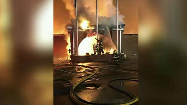 Virginia firefighters save American flag flying outside burning building