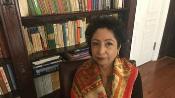 Pakistan's UN Ambassador Maleeha Lodhi reacts to the latest in the Kashmir conflict