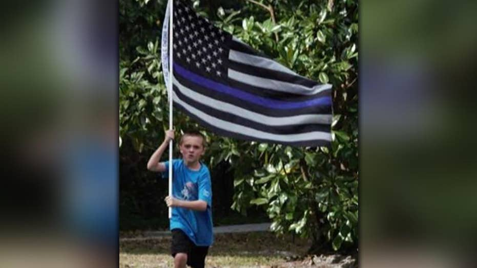 10-year-old pledges to run 150 miles to raise money for fallen officers