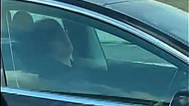 Man caught sleeping behind the wheel of his Tesla as it drives down a busy highway