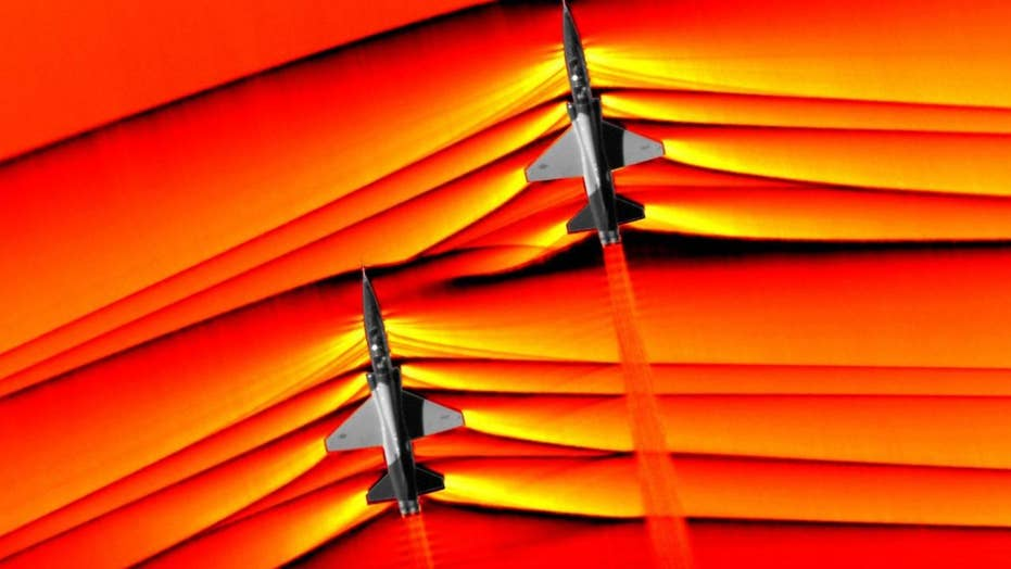 NASA captures stunning images showing colliding shock waves from two pairs of T-38 jets flying at supersonic speeds