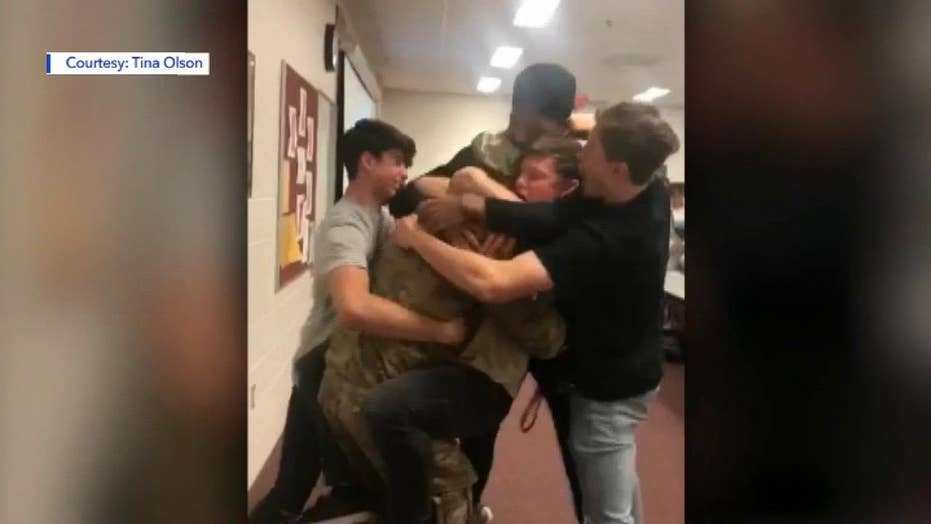 Students brought to tears when their coach returns from the Middle East