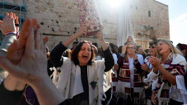 Clash at the Western Wall between thousands of young ultra-Orthodox Jews and a liberal Jewish women's group