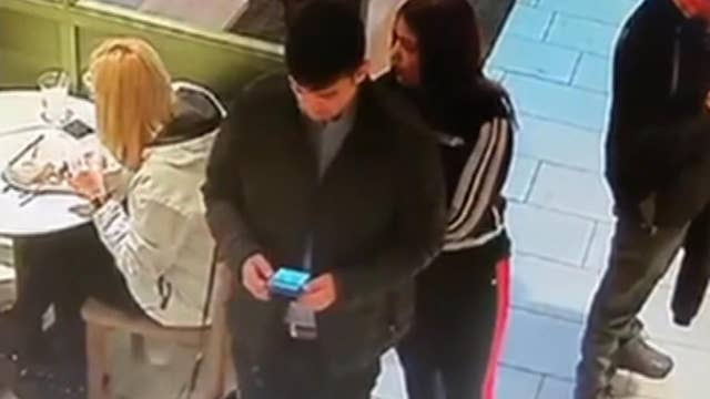 Caught on camera: Pickpockets steal woman's wallet