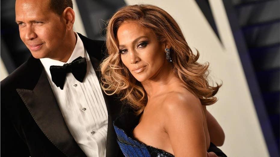 Jennifer Lopez strikes a pose in green bikini with boyfriend Alex Rodriguez