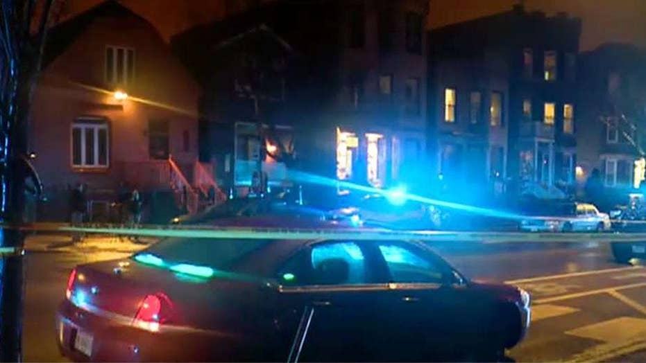 A Chicago police officer is in critical condition after being shot while serving a warrant
